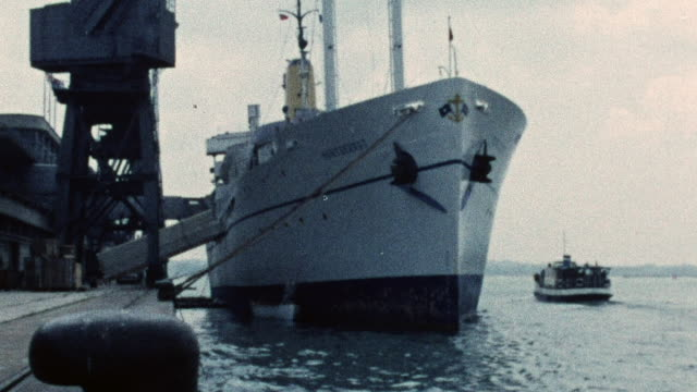1974 MONTAGE Cargo ships in port dockside along the quay / Southampton, Hampshire, England