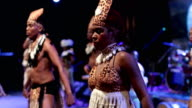 A Caribbean dance ensemble dances Afro-Caribbean dances