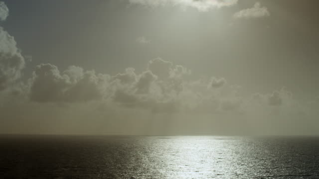 WS PAN Caribbean sea with sunset rays filtering through clouds / Vieques, Puerto Rico, United States