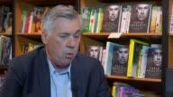 London INT Carlo Ancelotti interview SOT re working with Roman Abramovich new Star Trek film appearance Wide shot bookshop Closeups books on shelves
