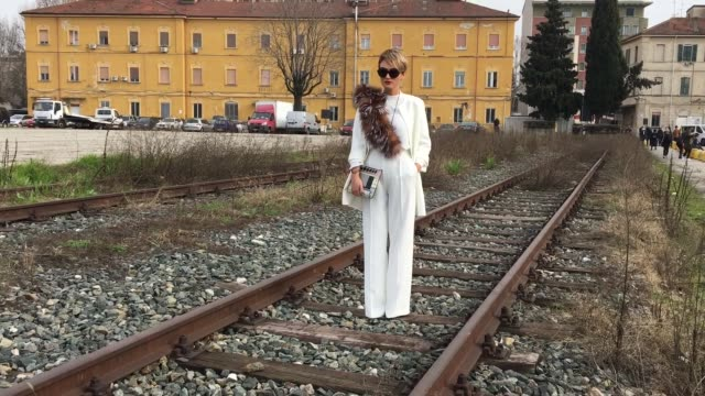 Carmen Negoita attending Gucci show on February 24 2016 in Milan Italy pants and shirt Zara coat Poema necklace Zara fur collar Parisi sunglasses...