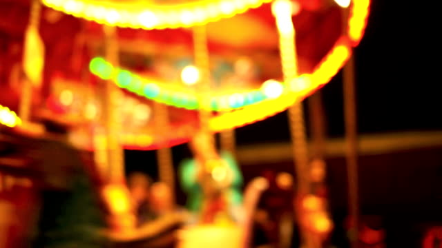 Carousel, circus and Amusement park with kids