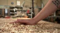 Carpenter  Brusing Off Wood Shavings