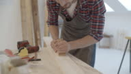 4K: Carpenter Carving Plank.