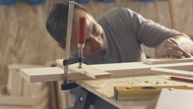 Carpenter clamping pieces of wood