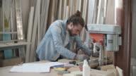 Carpenter Drilling Wood In His Workshop