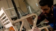 Carpenter Examining The Chair