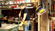 DOLLY HD - Carpenter / Joiner Sawing Wood in Workshop