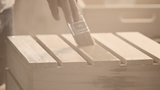 Carpenter painting wooden furniture