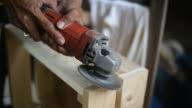 Carpenter Polishing Wood.