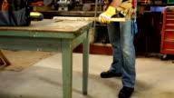 CRANE HD: Carpenter / Repair man using Saw in Workshop
