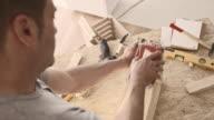 Carpenter sanding wooden box