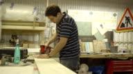 Carpenter working in wood workshop