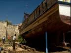 Carpenters work on a replica on Noah's Ark.