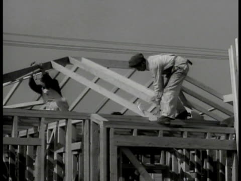 Carpenters working on incomplete rooftop Welder w/ torch mask working on metal Carpenter hammering window sill Blacksmith hammering hot bar Worker...