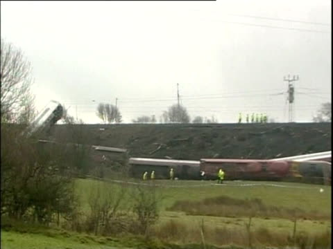 Carriages of derailed train after rail accident in Cumbria
