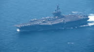 A US carrierled strike force heading for waters off the Korean Peninsula was spotted navigating the Tsushima Strait between the Kyushu region and the...