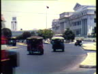 1953 WS Cars and busses travel along busy street / Philippines / AUDIO