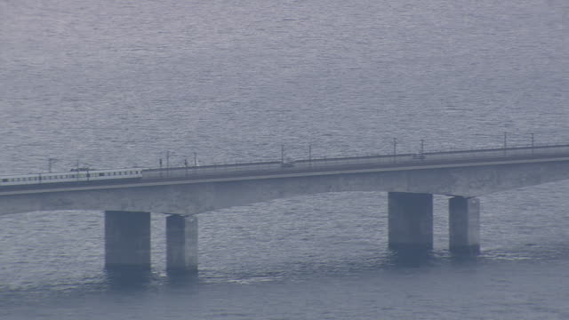 WS AERIAL TS ZO Cars and train on Great Belt Bridge  / Funen, Denmark