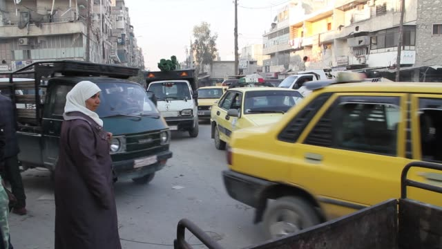 Cars and trucks drive in traffic in central Aleppo Syria