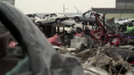 Cars being crushed at a scrapyard in China