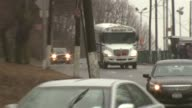 Cars corrections bus and trucks pass in front of camera near Rikers Island