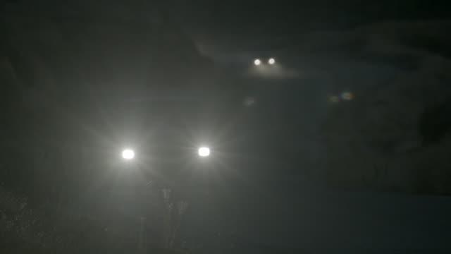 WS Cars driving along road at night