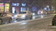 WGN Cars Driving In The Snow In Downtown Chicago At Night on February 08 2013 in Chicago Illinois