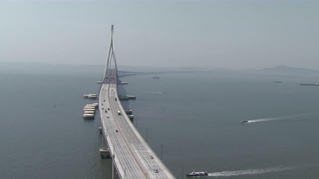 AERIAL Cars driving on Incheon Bridge / Incheon, South Korea