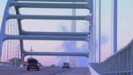 cars driving over bridge