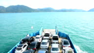 cars loaded on a ferry and headed for the island , Koh Chang , Trat, Thailand.
