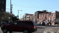 WS Cars moving through a busy city intersection / Philadelphia, Pennsylvania, United States
