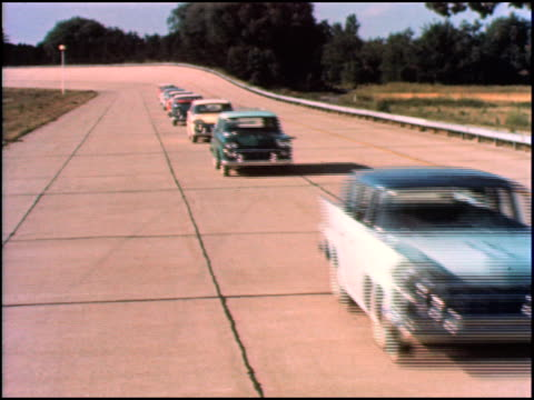 AMC cars on a test track drive past the camera Ramblers followed by Ambassadors 1958 AMC cars driveby on August 01 1957