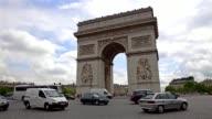 Cars passing by at Place de l'Etoile in front of Arc de Triomphe in Paris
