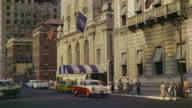 1953 WS Cars passing by front of the Savoy Plaza hotel on FIfth Avenue / Manhattan, New York