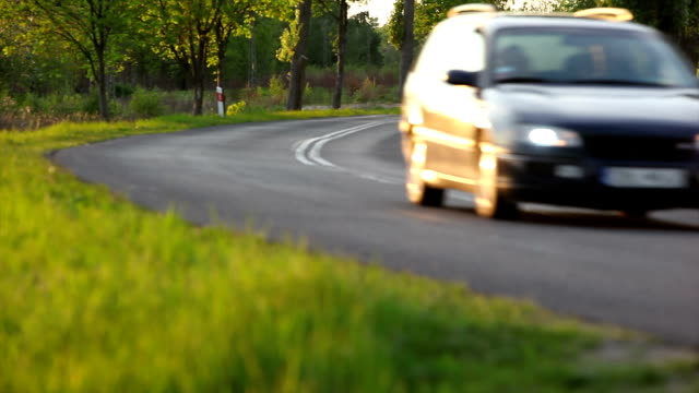 Cars passing by on the road