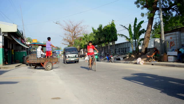Cars, scooters and tricycles on a busy street in Philippines