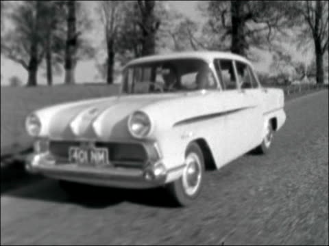 Vauxhall Victor on show for first time ENGLAND Bedfordshire Woburn Abbey Grounds Vauxhall 'Victor' towards at speed / CS ditto / CS wheel / Steering...