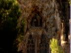 Carved figures adorn a column at the Sagrada Familia in Barcelona Spain.