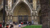 MS Carved portal at North entrance of Westminster Abbey with people in foreground, London, United Kingdom