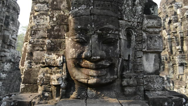 MS Carved stone face in Bayon Temple / Angkor Wat, Siem Reap, Cambodia