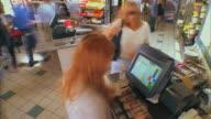 T/L MS HA Cashier at register at Santa Barbara City College cafeteria / California, USA