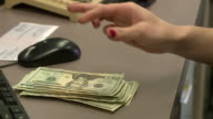 CU Cashier handling money, Bethlehem, Pennsylvania, USA