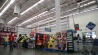 A cashier rings up a customers items inside a Sams Club store in Mexico City Mexico Wide panning shots of customers unloading their shopping carts...