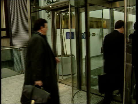 Stephen Byers meeting ITN ENGLAND London Department for Trade Industry EXT Bank executives along as arrive for talks on cash machine charges with...