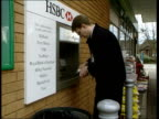 Stephen Byers meeting ITN Man withdrawing cash from HSBC Cashpoint machine