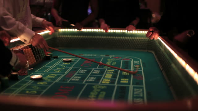 Casino footage, gambling chips and dice on craps table