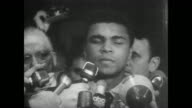 Cassius Clay steps out of US Customs House in Houston to crowd of waiting press as he faces a possible 5year prison term for efusal to take the oath...