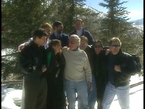 VS Cast of Animal House smiling posing for group photo in Aspen Co
