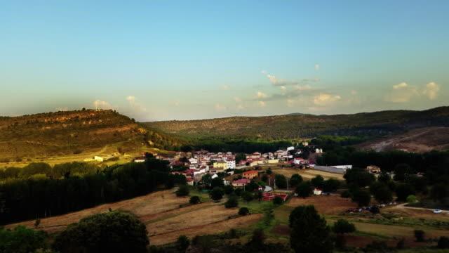 castilla de la mancha spain little town Tejadillos sunrise time-lapse from far away